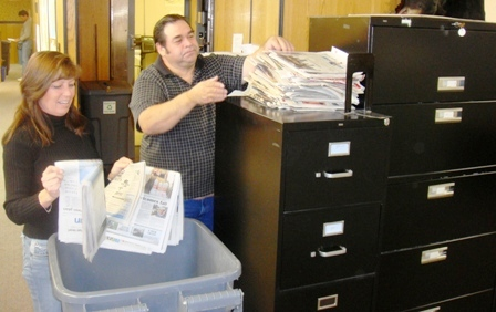 Wanda Whitworth and Clarence Skaw recycling newspaper at NRD Office